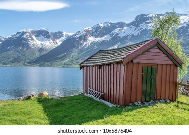 Boathouse at a lake . Photo taken  on Flo in Oppstryn , in Norway .