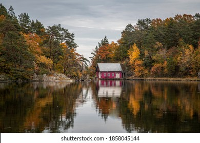 Boathouse next to a lake on an overcast autumn afternoon