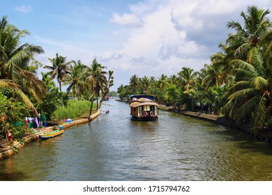 Boathouse sailing in the backwaters in Alappuzha, which is also known as Alleppey, Kerala, India.