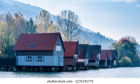 boathouses at lake Großer Alpsee in the Allgäu Alps