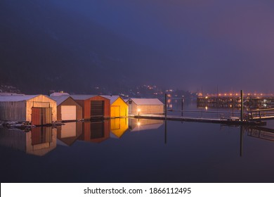 Boathouses on Kootenay Lake on calm winter's evening in Nelson, B.C.