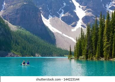boating at beautiful moraine lake at banff national park, alberta, canada