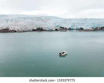 Boating in front of the majestic Nordenskiöldglacier in the Svalbard summer.