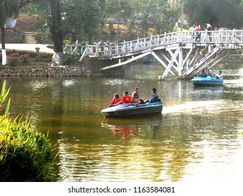 Boating in the mist with peasure in the Ward's Lake Shillong Meghalaya northeast India