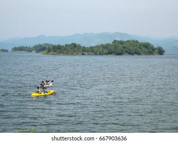 Boating on a lake in Kaeng Krachan, Thailand