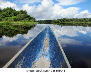 Boating on a lake in rainforest in Ecuador