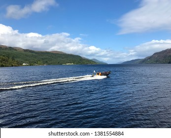 Boating on Loch Ness, a freshwater lake in the Scottish Highlands Southwest of Inverness in Scotland, United Kingdom