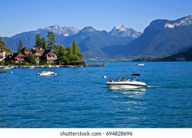 /Boating at Pere Bise point/Restful town of Talloires, France, on the lake Annecy. Water sports, calm and peaceful bays and coves, swimming and relaxing.