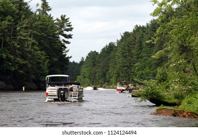 Boating at the Wisconsin river (USA) - while on an Upper Dells boat tour. Landscape and other recreational boats visible.