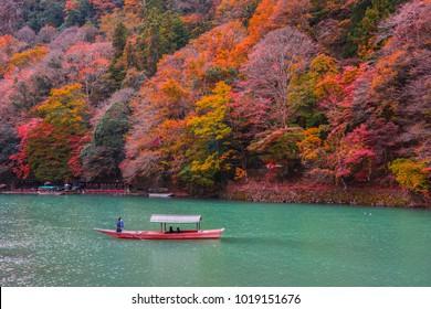 Boatman punting the boat at Katsura River