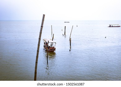 The boatman was sleeping on his boat. While waiting for passengers.