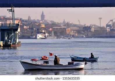 Boatmen are taking boat in the Golden Horn at sunset /Eyup,Istanbul,Turkey,Marc 2012