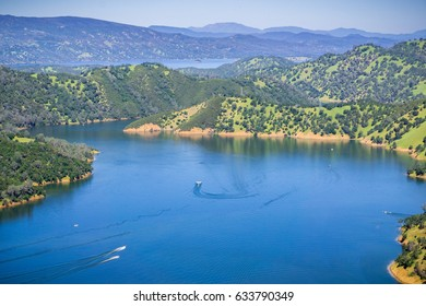 Boats after leaving Pleasure cove in south Berryessa lake from Stebbins Cold Canyon, Napa Valley, California