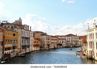 Boats along the Grand Canal of Venice in daylight.