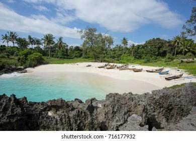 Boats anchor on the Mandorak Beach shoreline at Southwest Sumba, Indonesia