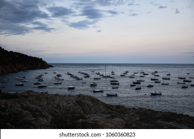 Boats anchored in a small bay in the Mediterranean sea.