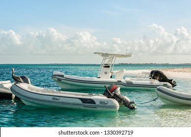 Boats anchored in turquoise waters at Las Aves Island, Venezuela. The Aves Island is a small Venezuelan island of 4.5 hectares located in the Caribbean Sea.