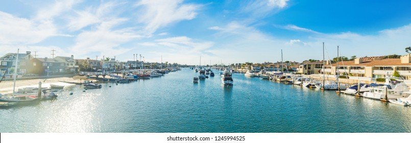 Boats in Balboa island harbor on a sunny day. Newport Beach, Orange County. Southern California, USA