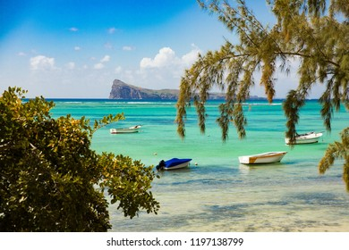 Boats at the beautiful coast of northern Mauritius, at the beach Bain Boeuf