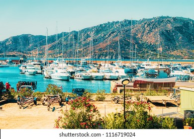 Boats at Beautiful Marina of Villasimius at the Bay of the Blue Waters of the Mediterranean Sea on Sardinia Island in Italy in summer. Cagliari region.