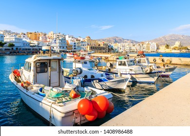 Boats in beautiful Pigadia fishing port with mountains in background, Karpathos island, Greece