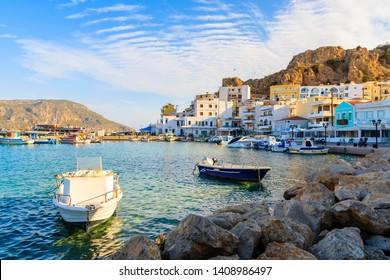 Boats in beautiful Pigadia fishing port at sunset time, Karpathos island, Greece