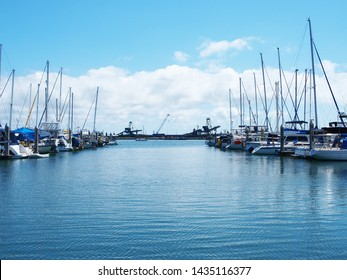 Boats berthed at a tropical marina in calm protected waters with blue sky backdrop. Safe haven for sailing and cruising vessels.  Keppel Bay, Great Barrier Reef, Queensland, Australia.