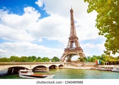 Boats, bridge Pont d'Iena and Eifel tower, Paris