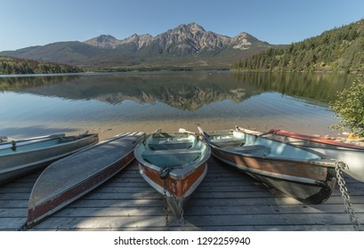 Boats by the lake in the Canadian Rockies, Jasper National Park in Alberta, Canada.