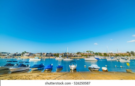 Boats by the shore in Balboa island, California