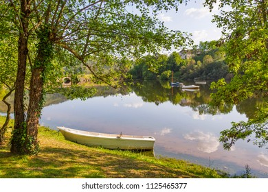 Boats in the calm waters of the Cachamuina reservoir in Pereiro de Aguiar, Ourense