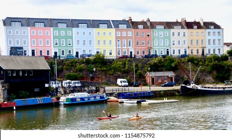 Boats and canoeists in the floating harbour at Redcliffe, a district of the English port city of Bristol in the city centre. Bristol, England Uk. August 2018