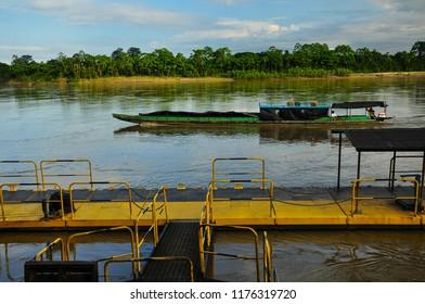 boats and cargo ships in the ariari river in san jose del guaviare