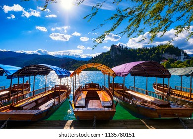 Boats and castle on a Bled lake, Slovenia. Famous tourist destination