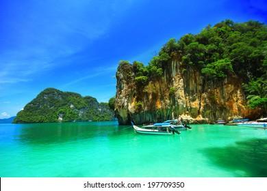 Boats and the clear sea at Phi Phi island, Andaman sea of Thailand.