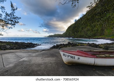 Boats coast and waves at Anse des Cascades near Sainte Rose city, Reunion Island