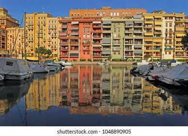 Boats and colorful houses in Port sa Platja