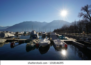 Boats, covered with their clothes, in sunny day in Locarno