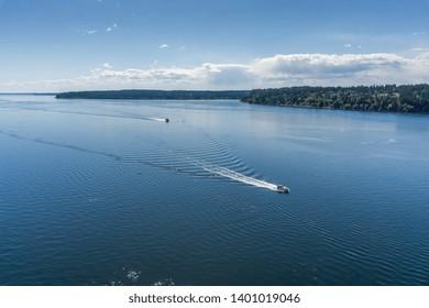 Boats cruise up the Tacoma Narrows strait.