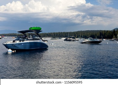 Boats and deep blue lake surface on Lake Tahoe on a sunny day in California