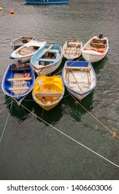 Boats and  dinghy moored up in the  Cornish fishing village and harbour of Mevagissey, Cornwall, England, UK