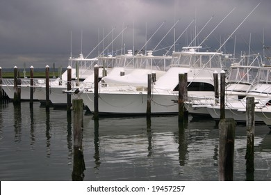 Boats docked in the harbor waiting for the storm to hit.