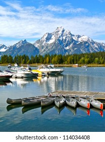 boats docked on Lake Jackson near the Grand Teton range in Wyoming