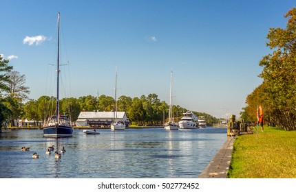 Boats exiting the Great Bridge Locks. Located in Chesapeake Virginia on the Inter-coastal Waterway heading south to North Carolina