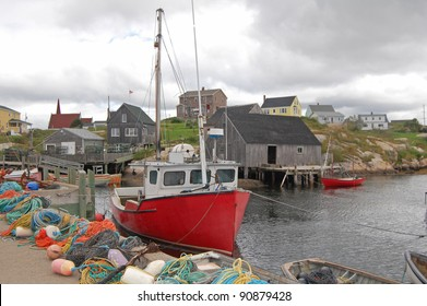 boats and fishing equipment on quayside in canadian fishing village
