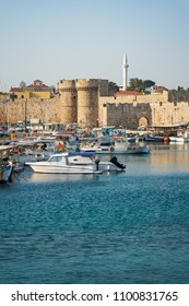 Boats in front of entrance gate of medieval city wall in City of Rhodes (Rhodes, Greece)