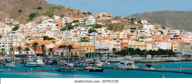 Boats in front of small town at the blue ocean coast with mountain background, Cape Verde