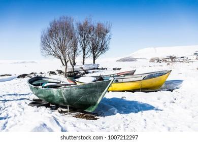 Boats at Frozen Lake