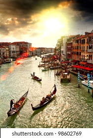 Boats and gondolas on the Grand Canal of Venice, Italy.