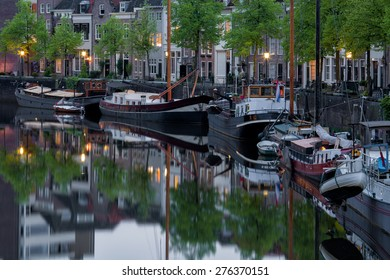 Boats in the harbor in the evening in the city center of den bosch, capital of province noord-brabant, in the old historical and characteristic town, netherlands, europe